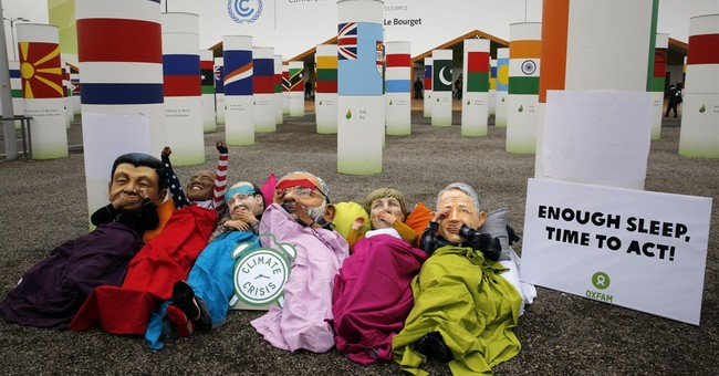 The Latest:  New climate draft shows headway on key issues