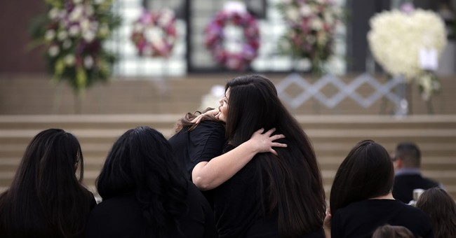 Funerals for 14 killed in California massacre somberly begin