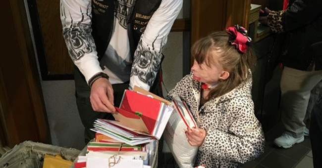 Christmas comes early to 8-year-old disfigured by fire