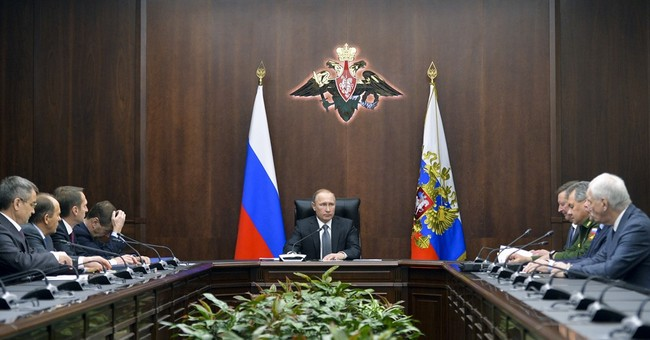 The Latest: Peskov: Russia not giving arms to Syrian rebels
