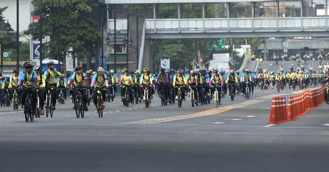 Thai crown prince leads mass bike ride to honor ailing king