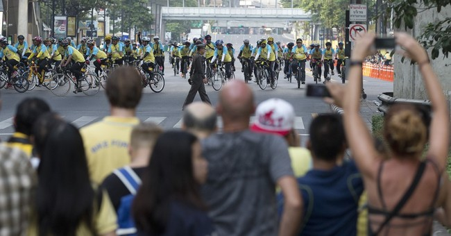 Thai crown prince leads mass bike ride to honor ailing king
