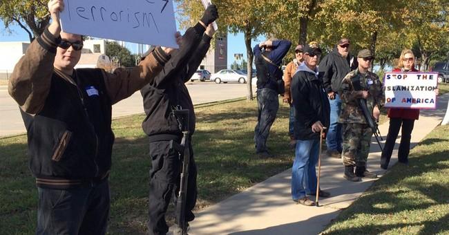 Armed 'patriots' turn protests toward Muslim Americans