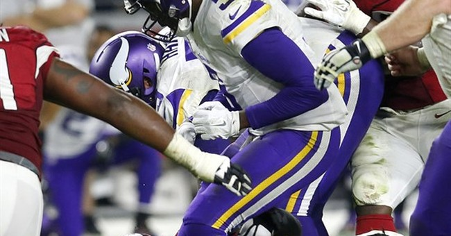 Vikings scare Cardinals, but Arizona's in the playoffs