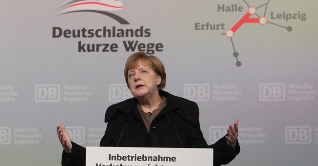 The Latest: Merkel against set limit to number of migrants