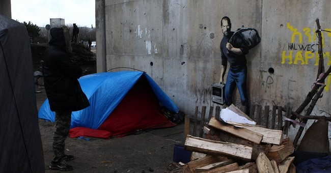Banksy takes on migrant crisis with Steve Jobs image