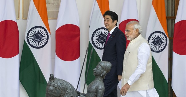 India and Japan sign deals on military, train sales, nukes