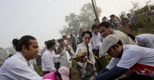 After election win, Suu Kyi gets to work cleaning up Myanmar