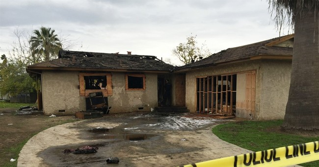 Officials seek cause of fire that traps squatters, killing 5