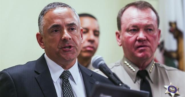 Police: Man fatally shot by LA deputies kept holding gun