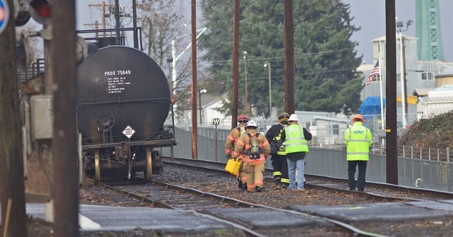 Deadly truck crash causes smoky Portland railroad yard fire