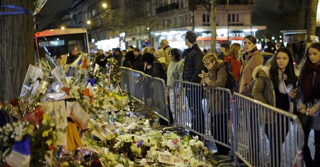 1 month after attacks, mourners gather in Paris
