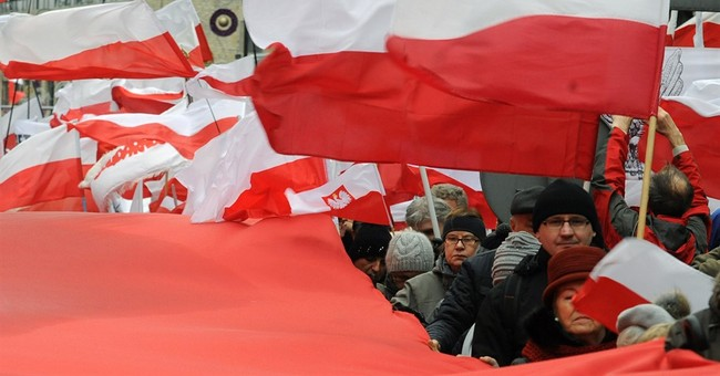 Thousands march in support of Poland's new government