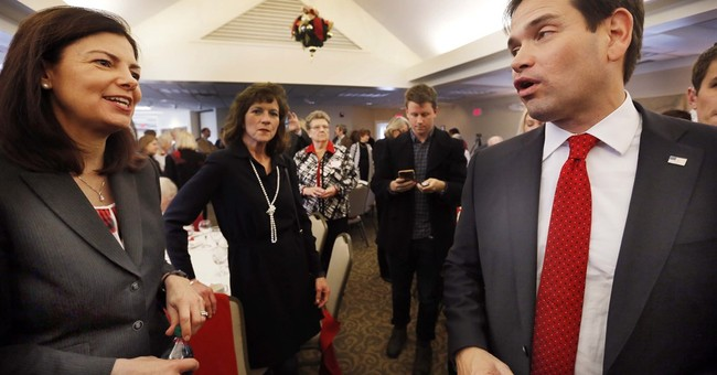 Wooing middle, New Hampshire senator risks losing the right