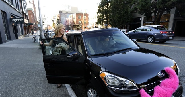 Seattle becomes first US city to let Uber drivers unionize