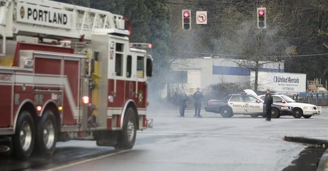 Deadly truck crash causes smoky Portland railroad yard fire