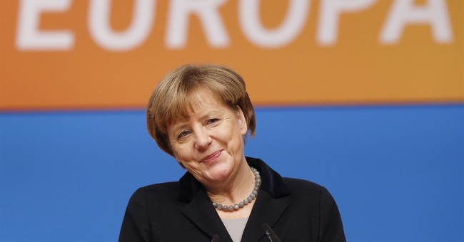 Merkel tells her party Germany will reduce migrant influx