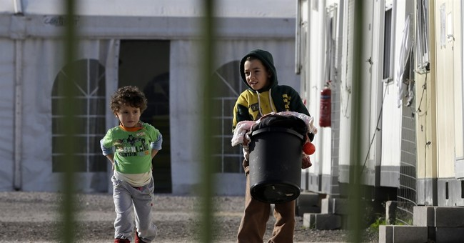 The Latest: Germany offers funds to improve migrant safety