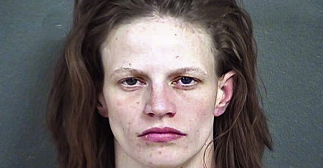 Kansas woman accused in killing of stepson, 7, hears charges