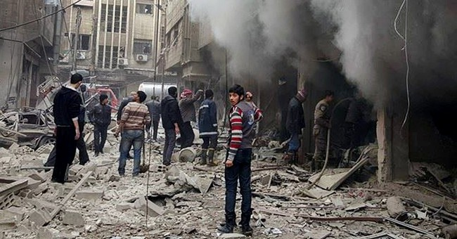 The Latest: Syria troops seize air base in rebel-held suburb