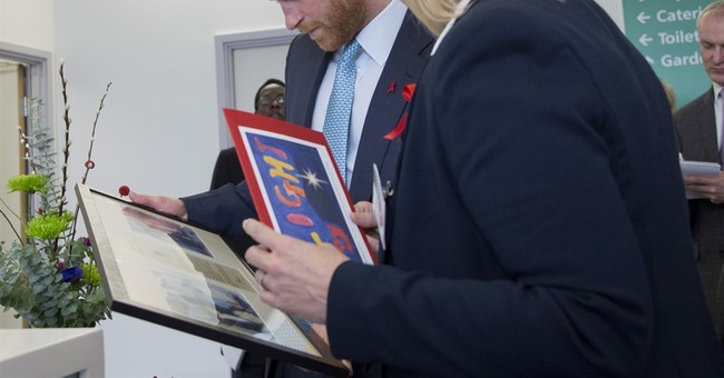 Prince Harry sees mother's legacy on visit to HIV hospital
