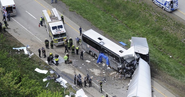 Truck driver says he blacked out before fatal tour bus wreck