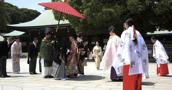 Japan court to rule on law requiring 1 surname per couple