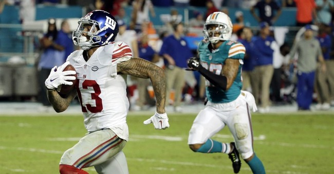 Giants forge 1st-place tie by beating Dolphins 31-24