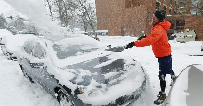 The Latest: Snowplow slips in Colorado during strong storm
