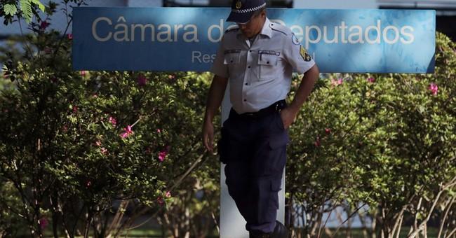 Brazilian police search house speaker's homes in graft probe