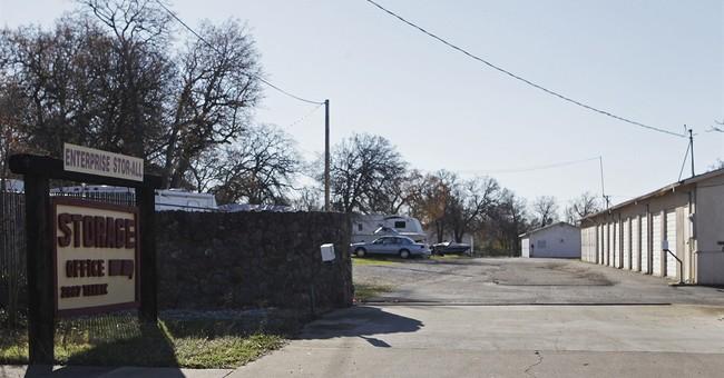 The Latest: 2 children found in storage died somewhere else