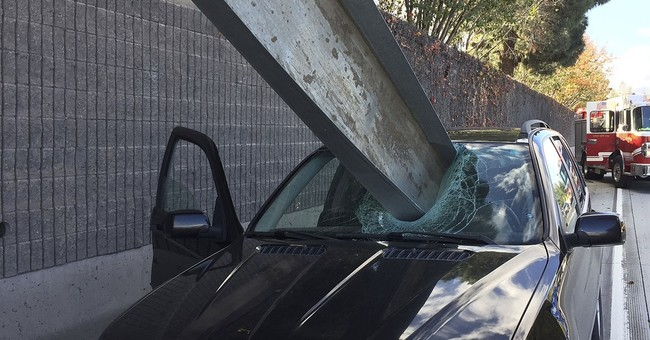 Driver dodges death when large metal beam pierces windshield