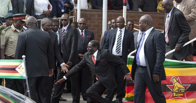 Zimbabwean government denies Mugabe fell down steps