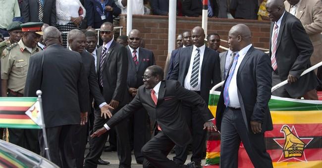 Zimbabwean government denies Mugabe fell down steps