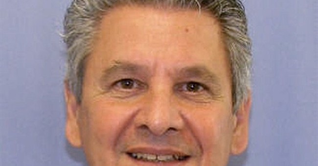 Ex-medical researcher gets life term in wife's cyanide death
