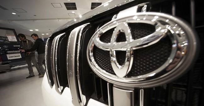 Toyota raises forecast after quarterly profit up on weak yen