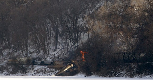 11 cars of train derail in eastern Iowa; 3 cars catch fire
