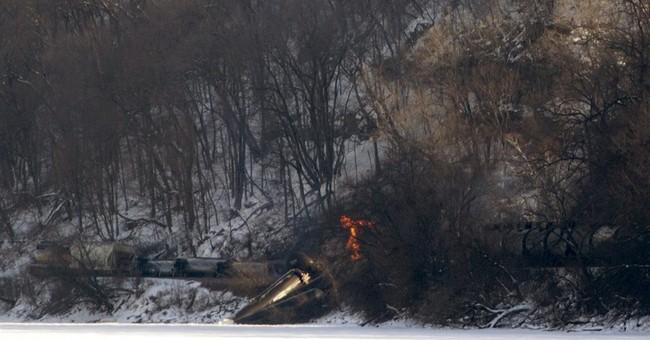11 cars of train derail in eastern Iowa; 3 cars catch fire