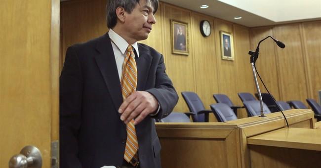 Prosecutor describes commune leader's reign at murder trial