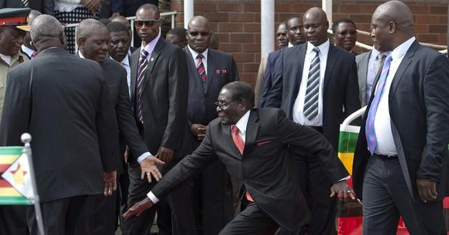 Zimbabwe President Robert Mugabe, 90, falls down steps
