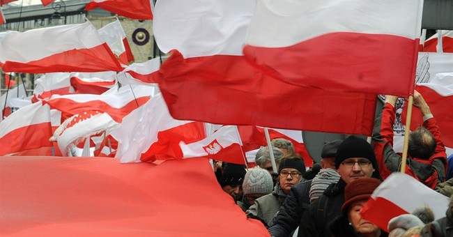 Poland's ruling party tries to solve conflict with new law