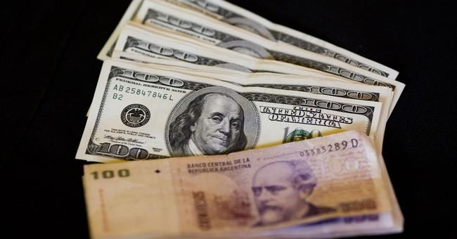Sharp devaluation of Argentine peso as dollar limits lifted