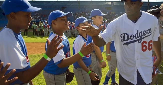 Cuban baseball defectors teach youth amid warming with US
