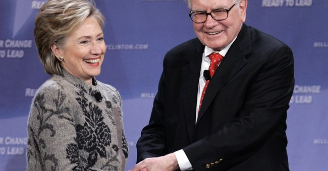 Clinton says she wants to go beyond 'Buffett rule' on taxes