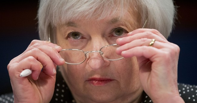 Fed raises its key interest rate from record low near zero
