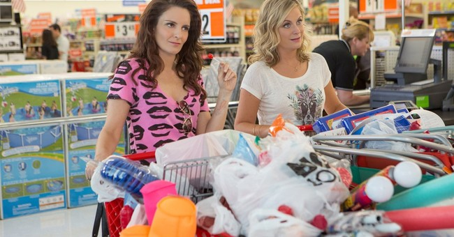 Review: Family ties of Fey, Poehler tested by 'Sisters'