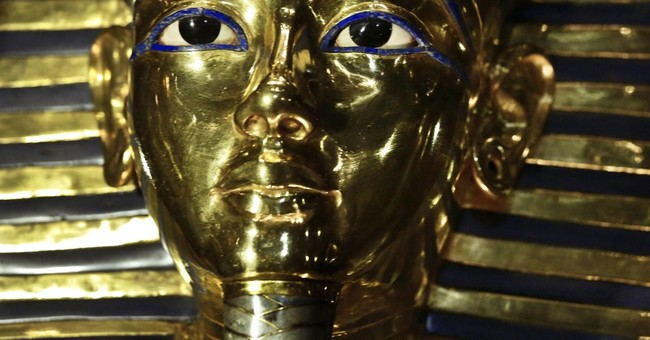 Egypt puts King Tut mask on exhibit after botched epoxy fix