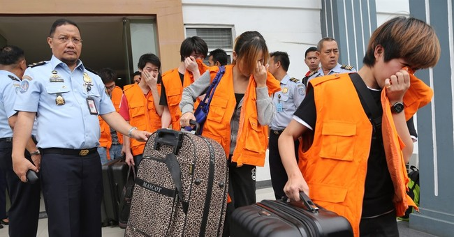 Indonesia deports 50 Internet scammers to Taiwan, China