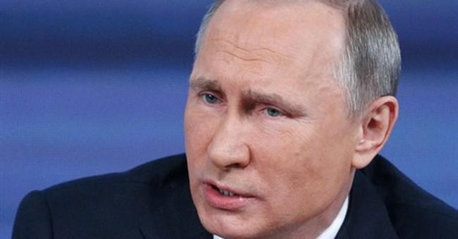 The Latest: Putin hopes for punishment of Nemtsov assassins