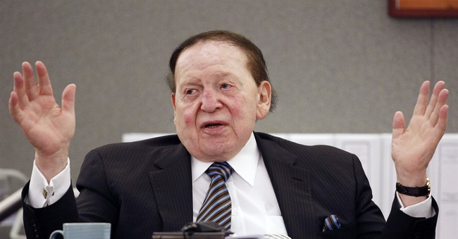 The Latest: Vegas newspaper seller defends Adelson buy